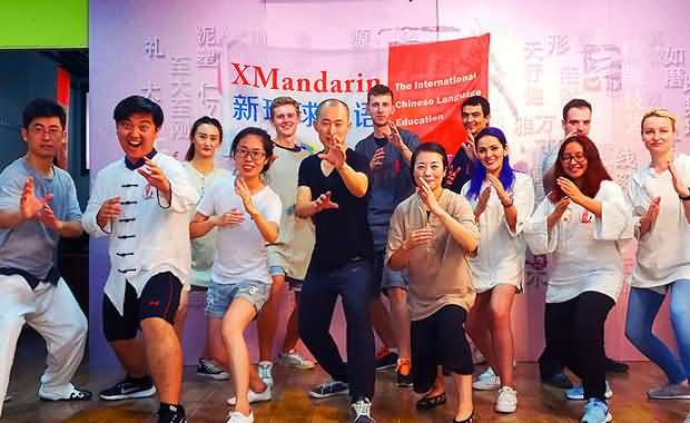 Xmandarin students and teachers doing a classic defensive pose, they learned Kungfu at a special cultural learning event